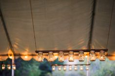 Not sure if you saw the previous pin of these mason jar 'chandeliers' in the daylight... pretty cool at night!