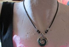 """New Listing Started silvertone/black cord 16""""long +round pendant swirl of abalone good condition £1.35"""