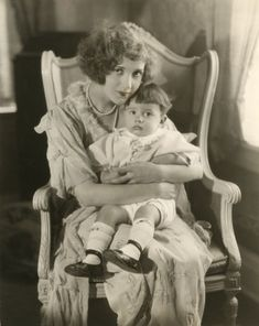 The silent film actress Constance Talmadge holds James Talmadge Keaton in her lap. James (also known as Joseph) was the first child born to Constance Talmadge's sister Natalie and Buster Keaton.