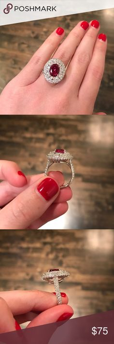 Finely crafted cocktail ring, cubic zirconia Stimulated Ruby and Cubic Zirconia. Cocktail ring. Size 5.5 Stamped 925 for 92.5% silver casting. Jewelry Rings