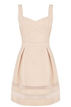 We've gone dotty for this beautifully designed structured skater dress. The piece features a modern jacquard polka dot texture across the fabric and on trend sheer insert panels on the hem. The piece has a sweetheart neckline and nipped in waist and is finished with a concealed zip fastening on the reverse.