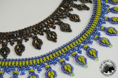 Learn to weave this fun necklace using Super Duos, Size 11 & 15 seed beads  and drop beads, which are optional. It isn't too complicated, but knowing  peyote for the toggle is a prerequisite and knowledge of RAW (Right Angle  Weave) is very helpful.  Prints out on 7 pages.  You may sell your finished items, but credit need be given! This design MAY NOT be taught or reprinted in any way.
