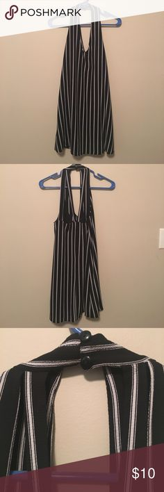 Striped dress Black and white striped dress with bottom closure around the neck. Gently used and in great condition. It's great for summer or layers for fall  La Hearts Dresses