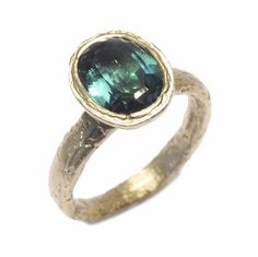 Diana Porter Jewellery unique blue tourmaline yellow gold engagement ring