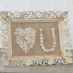 Beautiful buttons, burlap and offwhite frame...