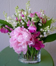 Short vase with peonys and lillys-of-the-valley from the June garden.