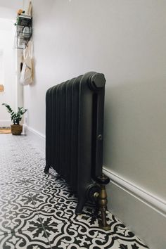 Ribbles Reclaimed Radiator In Pewter - Utility And Boot Room With Down Pipe Painted Custom Tiles And Patterned Tile Floor. Future House, Black Radiators, Wall Radiators, Victorian Hallway, Tiled Hallway, Hallway Inspiration, Hallway Designs, Hallway Ideas, Art Deco