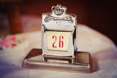 Vintage wedding prop. Queen's Coronation calendar. 1950s tea party wedding ©maria farrelly Photography