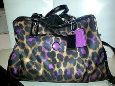 My husband brought this home tonight:)My new Coach.Love Purple leopard