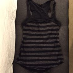 Lululemon black and gray striped tank Black and gray striped racerback style tank. No shelf bra or cups inside. EXCELLENT condition!! lululemon athletica Tops Tank Tops
