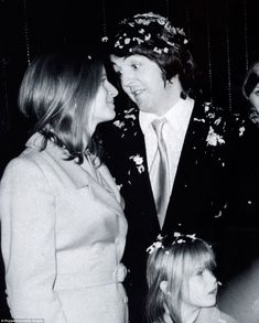 Paul, the last of the Beatles to marry poses with his bride Linda Eastman and her daughte...