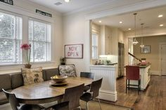 Welcoming Dutch Colonial Home in Texas, open kitchen nook with pony wall and banquette Window Seat Kitchen, Kitchen Nook, Kitchen Seating, Kitchen Dining, Dining Area, Kitchen Ideas, Kitchen Banquette, Dining Table, Table Bench