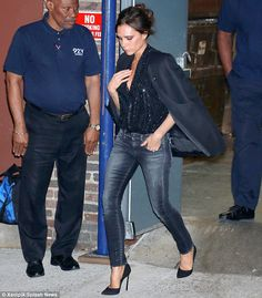 In a hurry: Victoria dashed out of the eatery in her high heeled black pumps, with a match...
