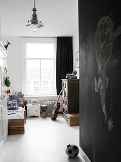 I also want to do a chalkboard wall in G's room.. I think he would love it