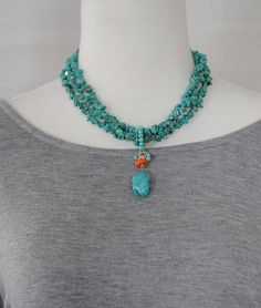 Elegant and timeless multi strands necklace features of turquoise chips beads with a dangling coral and turquoise stone. Look beautiful with your jeans or your summer wardrobe. Necklace measures 15 inches long plus 3.5 extension chain . Please visit my shop often, items will be updated often. Please read my information about shipping, payment and conditions located in my store policies section before committing to purchase. https://www.etsy.com/shop/stylelovers/polic...