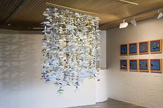 Origami dolphins hang in gallery at Waikato Museum. / ©: Waikato Museum