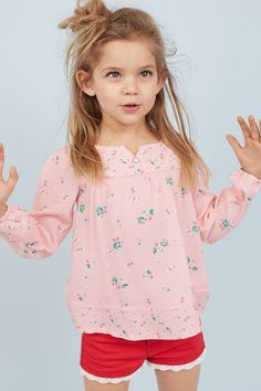 Wide-cut blouse in soft woven viscose fabric with a printed pattern. Button at top yoke with decorative gathers and long sleeves with covered elasticized cuffs. Sweet Romantic Quotes, Strawberry Blonde Hair, Girls 4, Baby Girls, Viscose Fabric, Girls In Leggings, Cute Little Girls, Blouse Patterns, Child Models