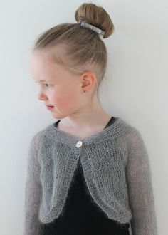 Knitted silvery bolero for a little girl