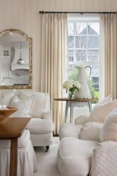 White living space with beige curtains, a shabby chic and also traditional style