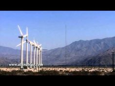 Windmills turn in the sunny California desert.   Purchase this clip from A Luna Blue:  http://www.alunablue.com/industry-stock-footage/ecology/wind-power-01/clip-05.html   A Luna Blue Stock Video.  Imagery for Your Imagination.  http://www.alunablue.com