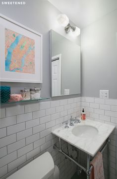 Find out how Amy transformed her outdated bathroom with Sweeten in this modern Brooklyn Heights bathroom renovation.