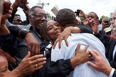 President Barack Obama hugs a woman in the crowd after addressing the Labor Day celebration in Detroit on Sept. 5, 2011.