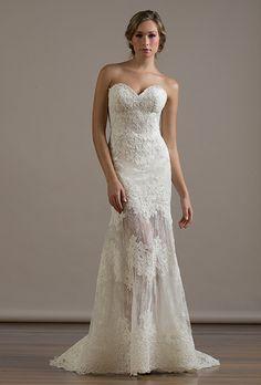 A sheer skirt on this @liancarlodesign wedding dress | Brides.com