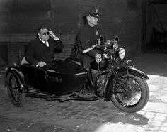 New York, 1939.  It's not quite the Batmobile, but it's still a pretty slick set of wheels. Mayor Fiorello LaGuardia jumps into a motorcycle sidecar and prepares for a lickety-split ride to a fire raging on Snediker Avenue in Brooklyn.