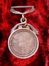 The silver medal awarded to my great-grandfather when he was a teenager. The medal and the story behind it inspired many scenes in 'Becoming Billy Dare'.