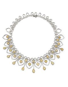 8 KARAT TWO-COLOR GOLD, DIAMOND AND YELLOW DIAMOND NECKLACE. Of openwork design, the collar set throughout with numerous round near colorless diamonds weighing approximately 22.15 carats, the front accented by pear and heart-shaped diamonds of yellow hue weighing a total of approximately 22.00 carats, length 15½ inches.