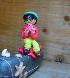 boy sit on the rock Gaspé