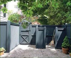 Universal Fence and Enclosure - A tidy yard is assured by a verde Universal fence with functional catch-all enclosure. A single arch and scallop gate form an appealing circle.
