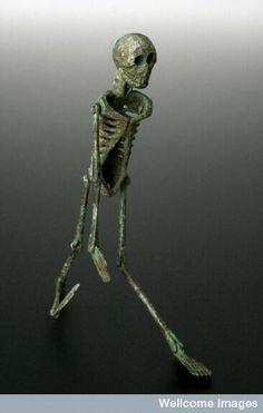 This is a special type of memento mori dating from 199 BC called a larva convivialis.It was given to revellers at a banquet or feast. Even when the Romans were enjoying themselves, they still were reminded of their mortality. For an unknown reason the right leg of the articulated skeleton has been substituted for a left arm. This is an extremely rare example. Wellcome Images.