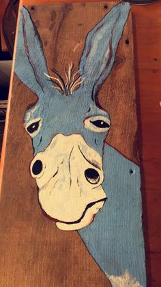 Painting of a donkey by Hannah Exel on an old barn board. 2017.