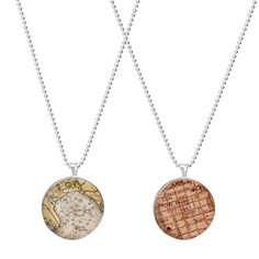 CUSTOM MAP PENDANT On The Map A style guide that never loses its charm, these personalized pendants represent your hometown, yearly getaway or favorite landmark on printed maps or charts. Even if you're miles away, you'll always have a special piece that's spot on.