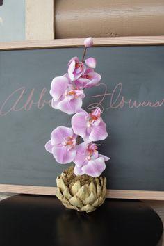 Fuschia Orchid Arrangement In Dried Artichoke by AbbiesFlowers, $34.00
