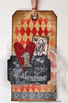 Hi everyone! Here's my version of Tim Holtz 12 tags of 2014 February. I finished it at the beginning of the month, but didn't get a chance to post until now.I liked the embossed stencil pattern in th