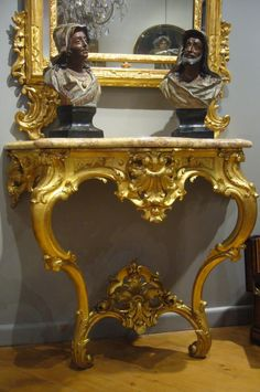 Console Louis XV style in giltwood, Rococo style, with two curved legs connected by a cross decorated with shells. Top in #brocatello #marble billed corbin. Early 19th century. For sale on Proantic by Au Passé Simple.