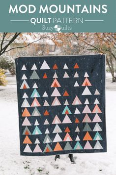 Mod Mountains from suzyquilts.com is a fresh and modern triangle quilt pattern. This design is fat quarter friendly and great for using fabric scraps from your stash. A video tutorial shows you step-by-step instructions for how to sew triangles. Make queen/full, twin, throw and baby quilt sizes. #scrappyquilt #modernquiltpattern #trianglequilt Baby Quilt Size, Baby Quilts, Modern Quilt Patterns, Pdf Patterns, Triangle Quilt Pattern, Quilt Sizes, Fabric Scraps, Diy And Crafts, Couture