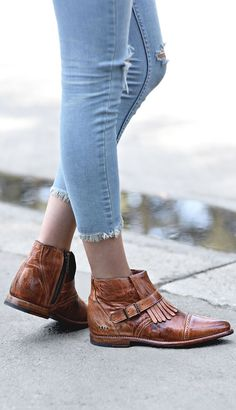 Dress up your light washed denim with these handmade tan leather booties by BEDSTU, Fringe and buckle detail add some extra flair.