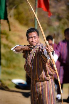 Ultimate guide to find the best anchor point for drawing a bow is a guide for beginners to find the best anchor point. Mounted Archery, Bhutan, Salt Of The Earth, Traditional Archery, Raw Beauty, Romantic Travel, Real People, Anchor, Photo Galleries