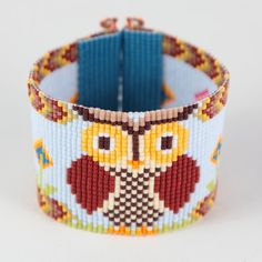 This one-of-a-kind Woodland Owl Bead Loom bracelet is both charming and whimsical! As with all my pieces, Ive created it on a bead loom with great care and attention to detail. IMPORTANT NOTE: This bracelet measures approximately 6 3/4 long. Please measure your wrist carefully before order placement, to ensure a proper fit. The beads used in this piece are my favorite - high quality glass Japanese Delicas, much more even and consistent than the beads most commonly used in loom work. This…