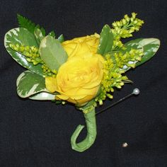 Yellow spray roses with solidago and pitt leaves bout