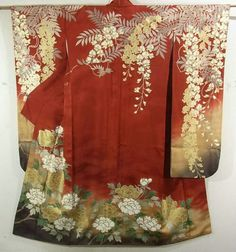 This is a glamorous Furisode Kimono with a design of 'fuji' (wisteria) and 'botan' (peony), which is dyed with gold glazing