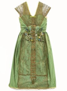 Woman's evening dress of bright leaf green and red shot silk, trimmed with gold embroidered net and passementerie, satin binding and silk flowers: French, Paris, by Lucile Ltd, c. 1918 - 1920