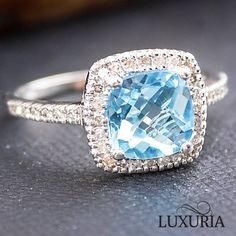 Beautiful sky blue topaz semi-precious gemstone with precious diamond halo and shoulders makes for a wonderful choice as an engagement or dress ring Blue Topaz Diamond, Diamond Gemstone, Halo Diamond, Gemstone Rings, Diamond Rings, Amethyst Jewelry, Birthstone Jewelry, Blue Rings, White Gold Rings