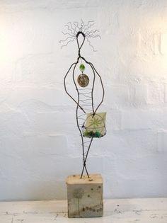 Earth Wire Sculpture Art on Driftwood  by:-Idestudiet