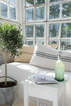 Gray grain sacks & olive topiary