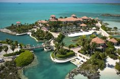 """Emerald Cay is a 2.32 acre private island located in the Turks and Caicos chain of islands. Emerald Cay features a remote-controlled bridge that leads to an elaborate castle, surrounded by a clear turquoise moat. It is said that Emerald Cay is one of the most luxurious private islands ever built. Among the many luxuries inside the 30,000 square foot castle """"home"""" is a three-story library and a 6,000 bottle wine cellar. There are also two adjoining swimming pools with a waterfall. It can be…"""