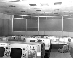 NASA Mission Control center, 1965. [A glowing red jewel called attention to the seventh meter from the bottom, fifth row to the left, on the east wall. - Player Piano]